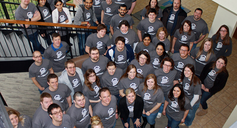Group of LCS employees wearing LCS shirts pose for group photo